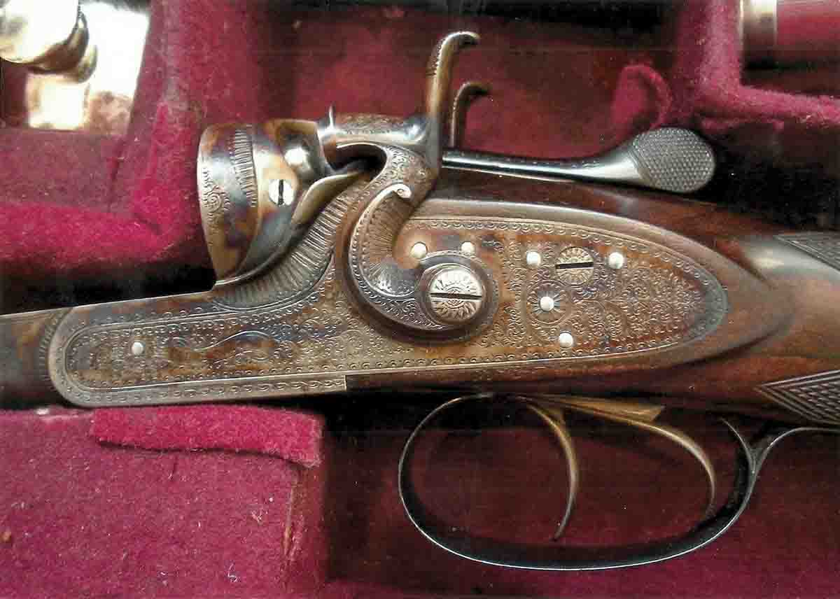 A view of the engraved side lock.