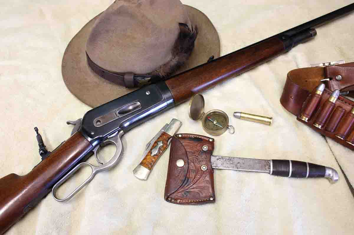 Harvey enjoys hunting with old rifles like his .45-70 M1886 Winchester. Older accessories, like this 1930's Winchester lock-back folding knife, old Boker hatchet and vintage brass compass usually go along.