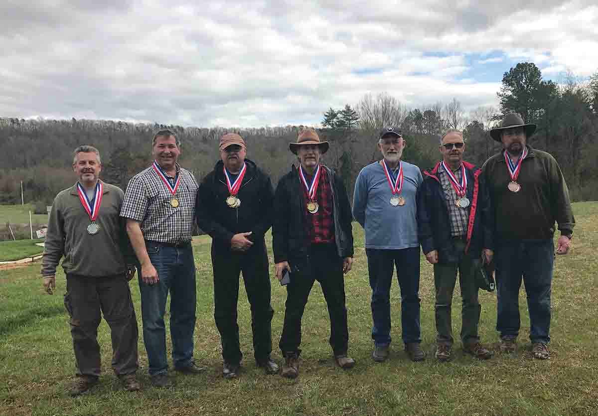 Top shooters of both matches (left to right): Al Roberts, Rick Weber, Ray Hopkins, Brent Danielson, Lee Shaver, Laurie Kerr, Art Fleener.
