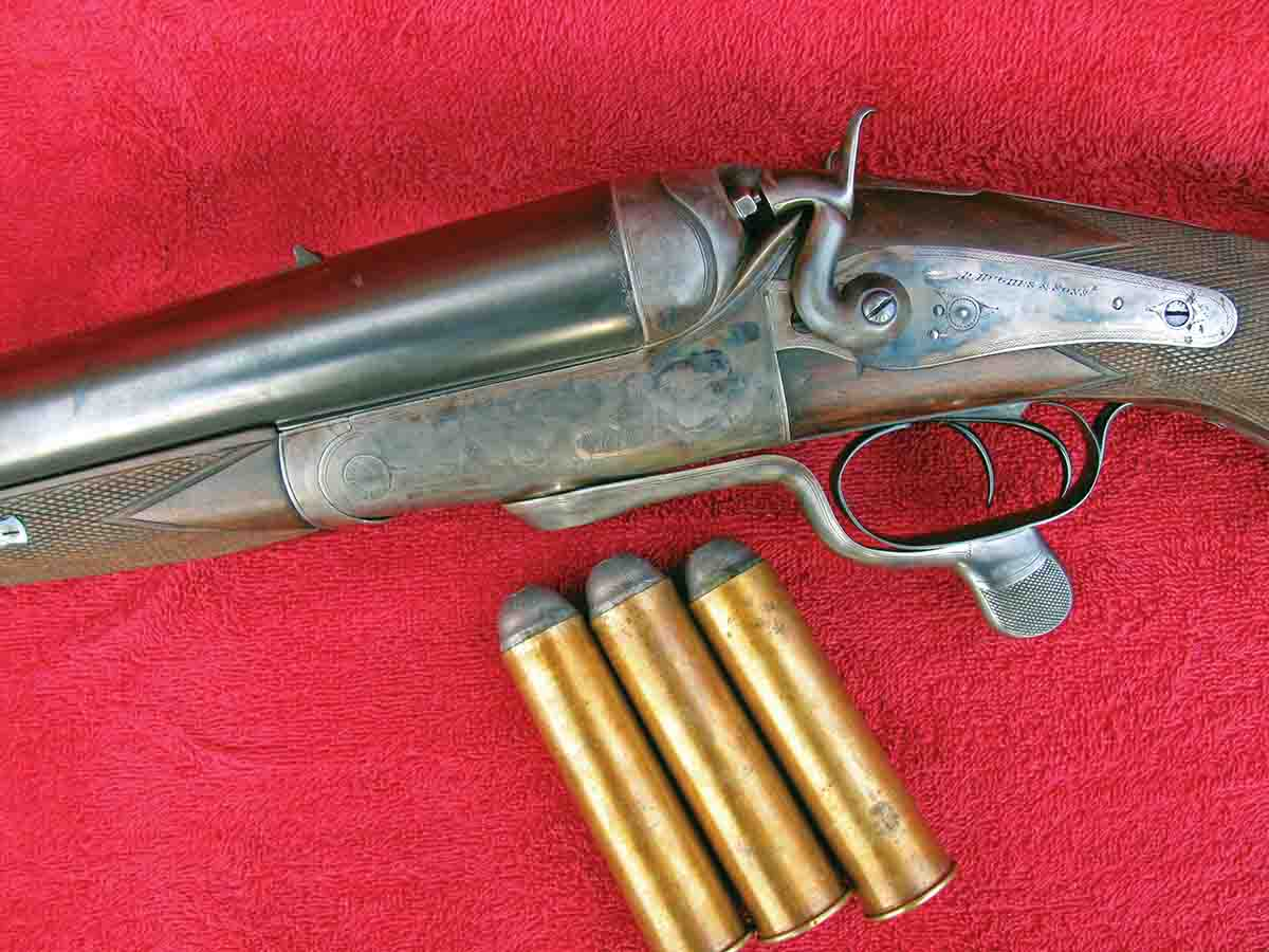 A Robert Hughes 4-bore, brass case is 4 inches in length, shooting 440 grains (16 drams) of FFg. It was made for 390 grains (14 drams) and a conical bullet of 4¼ ounces or 1,882 grains. The rifle weighs 22 pounds and is 23 pounds when loaded!