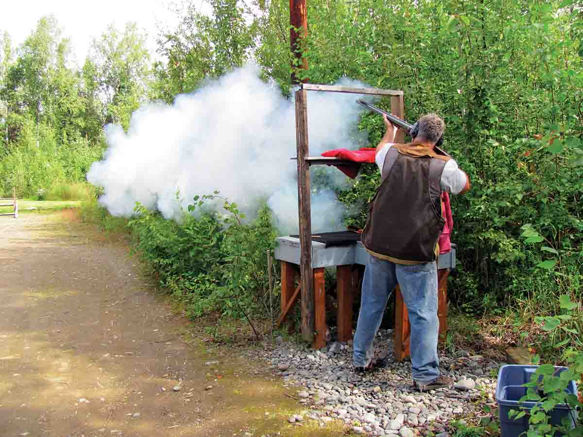 Shooting a full load from the Robert Hughes 4-bore double rifle.