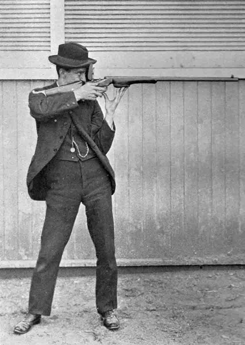 Dr. Walter G. Hudson, expert offhand rifle shot, demonstrating his offhand position. Note the blocked forearm to facilitate a hip-rest position without using a palm rest. From Modern Rifle Shooting by W.G. Hudson, M.D.