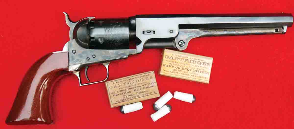 The Colt Navy revolver and the new Buffalo Arms combustible cartridges. Note the period labels on the cartridge boxes.