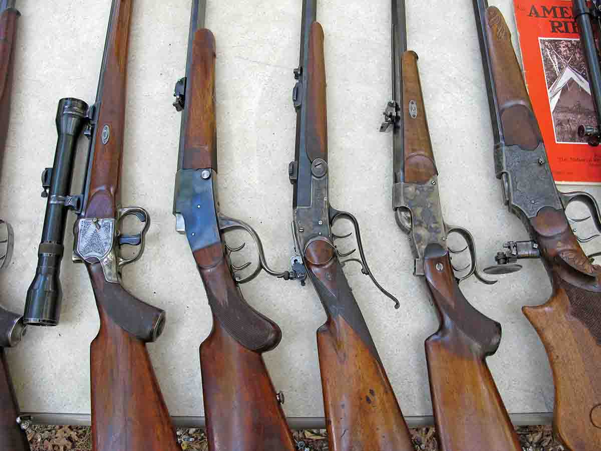 A table full of fine German stalking rifles.