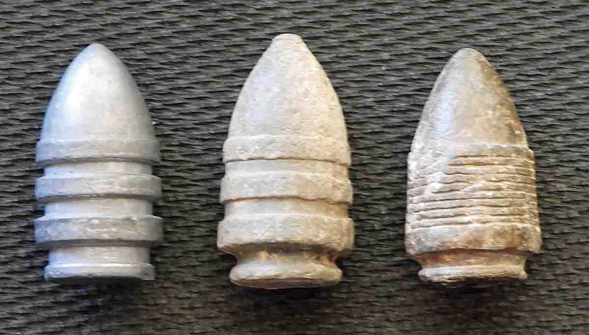 Test bullet shown along with two types of original bullets. The three-band in the center is the most common for this era, with the bullet on the right being the rare Gomez & Mills multi-groove.