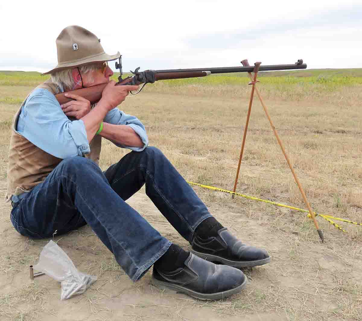 The author's cross-stick technique at the Quigley match, breaking in the new C. Sharps Arms .44-70 Model 1874.