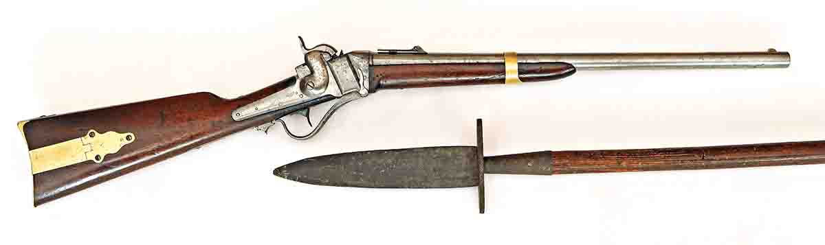 "Model 1853 military carbine, and a full-length pike from the abolitionist John Brown, with assembly number 175. The three parts for each pike were given the same assembly number so they could be disassembled for shipment to avoid suspicion, and then reassembled correctly for use at Harpers Ferry, Virginia. The handles were boxed together as ""farm implement handles."""