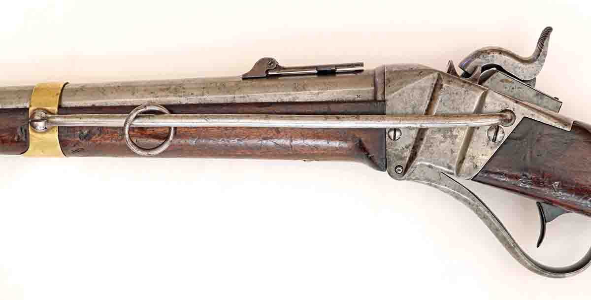 The nine-inch sling bar and ring for attachment of the wide carbine sling. The bar, ring, and sling were intended to prevent the soldier from dropping his carbine while on horseback. The bar was later shortened to prevent the carbine from flipping muzzle-up while bouncing around on horseback.