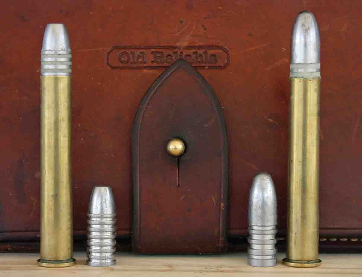 The Farmingdale .45-110 Sharps has about a half inch of freebore, which requires bullets to be seated out further than normal. At left is Harvey's hunting load using Lyman's 457121 bullet and tallow lube, on the right the long-range load using a Paul Jones 550-grain bullet and SPG Lube.