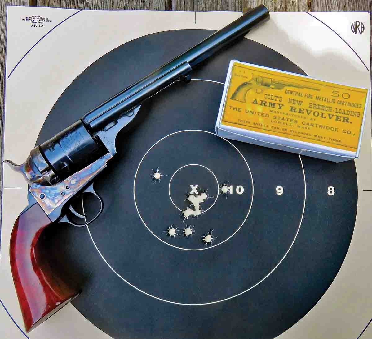 10 shots with Mike's .44 Colt by Cimarron Firearms shows a score of 100 with 5Xs