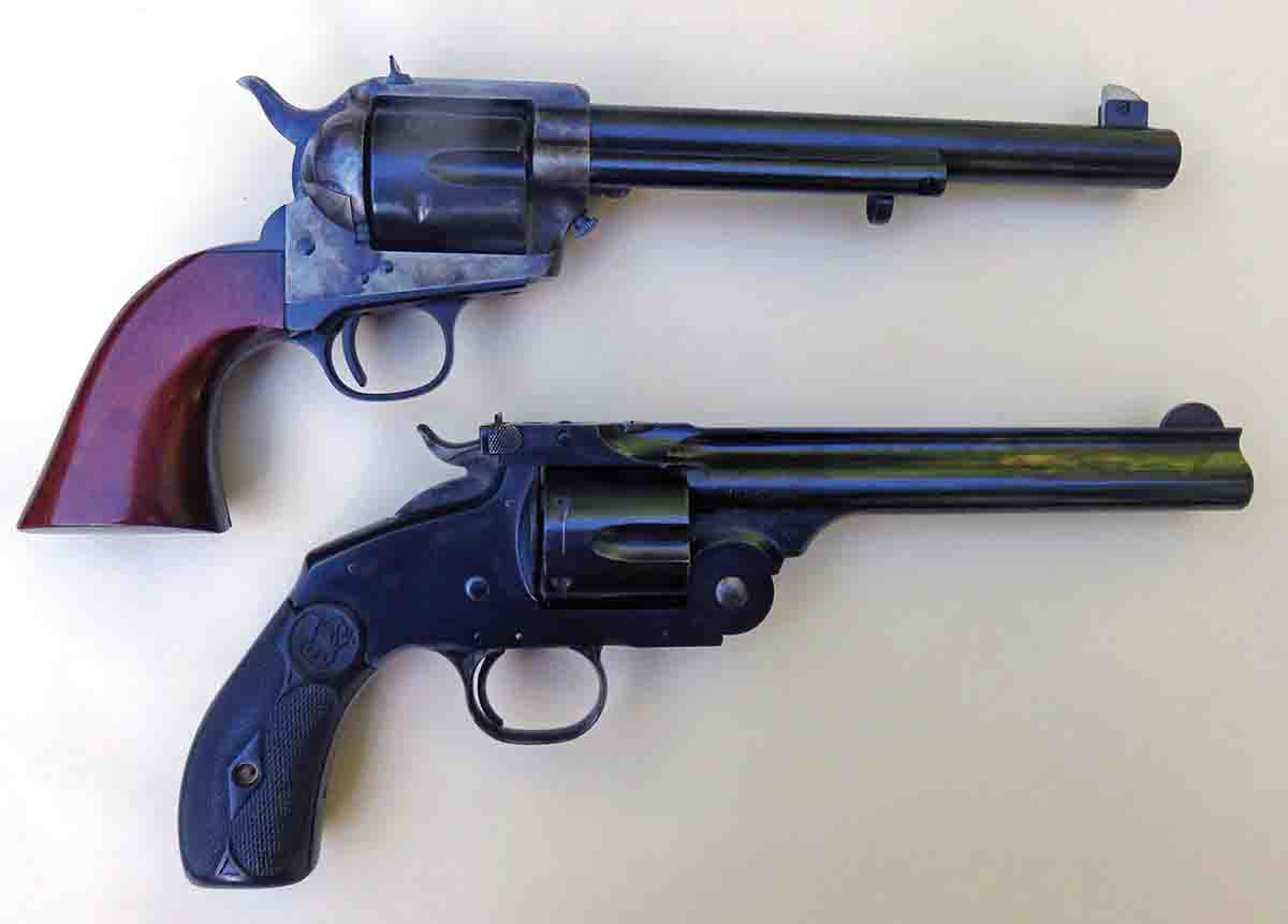 The two revolvers with 1880s-style target sights are the Flattop Colt-style and the S&W New Model #3 Frontier Target.