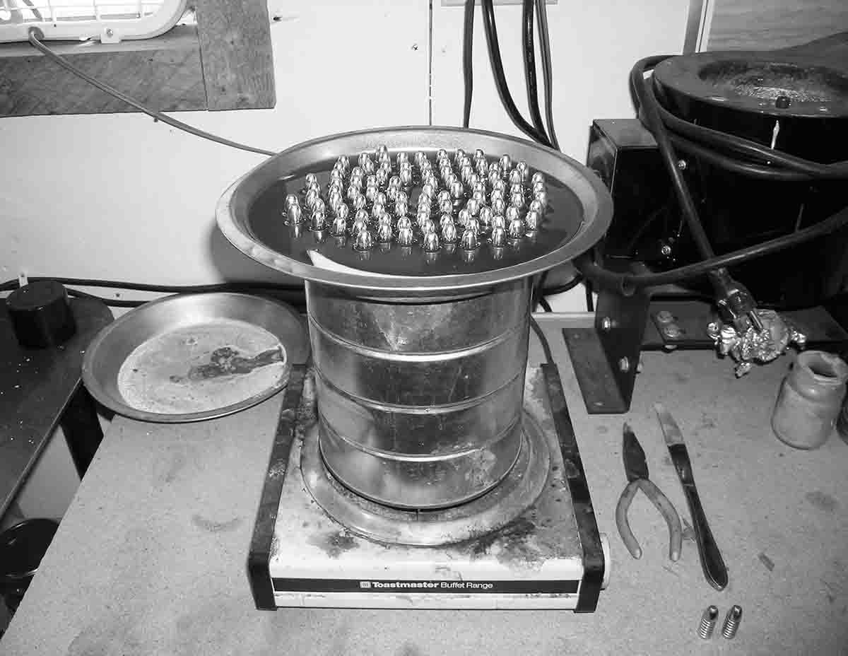 Double boiler for pan lubing utilizing a coffee can for a water tin and pie tin for a bullet tray.